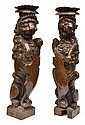 A PAIR OF 17TH CENTURY OAK TORCHERES CARVED AS RAMPANT LIONS, WITH POLYCHROME REMNANTS