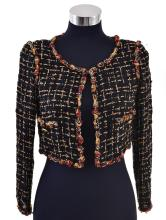 A CROPPED JACKET BY CHANEL