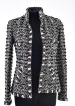 A JACKET BY CHANEL