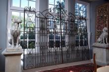 A PAIR OF IMPRESSIVE SPANISH PROVINCIAL STYLE WROUGHT IRON GATES (270cm H x 155cm W each gate)
