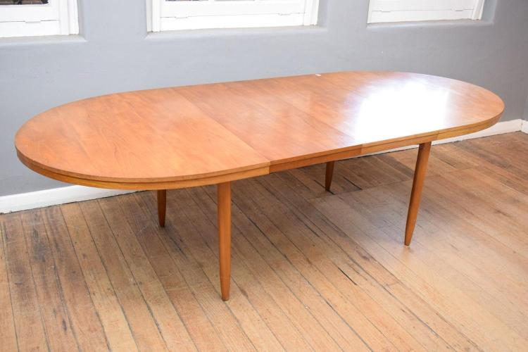 A 1970 39 S TEAK OVAL SHAPED EXTENSION DINING TABLE W TWO AD