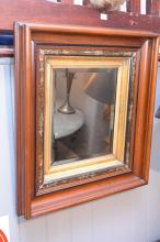 AN EARLY 20TH CENTURY ORNATE SQUARE SHAPED GILT FRAMED TIMBER MIRROR