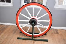 A VINTAGE PAINTED WAGON WHEEL (130 X 130)