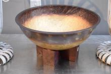 A DECORATIVE BOWL WITH TIMBER STAND