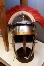 A REPRODUCTION ROMAN HELMET