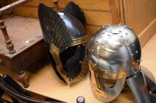 A REPRODUCTION VIKING HELMET AND ANOTHER HELMET