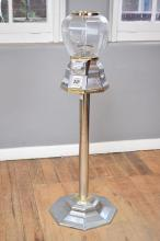 A CHROME AND GLASS MOUNTED GUMBALL MACHINE, 130 CM TALL - keys in office