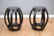 A PAIR OF CHINESE BLACK LACQUERED OPEN DRUM STOOLS