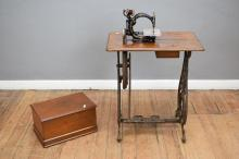 AN ANTIQUE TREADLE SEWING MACHINE 'WILCOX AND GIBBS' 1870S
