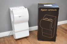 A DYSON AIRBLADE MODEL 'AB-03' BRAND NEW IN BOX WITH INSTRUCTION MANUAL, WALL BRACKET, AND AUSTRALIAN PLUG