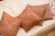 A COLLECTION OF ASSORTED PAISLEY CUSHIONS AND MATCHING FOOTSTOOL
