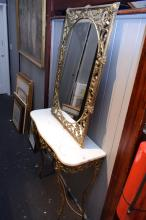 A FRENCH GILT METAL CONSOLE WITH MARBLE TOP AND MATCHING MIRROR