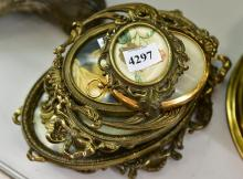 A COLLECTION OF NOUVEAU BRASS FRAMED WORKS
