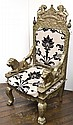 A SILVER OVERLAY THRONE STYLE CHAIR WITH LION ARMRESTS UPHOLSTERED IN BLACK AND BEIGE CLOTH