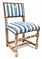 A SET OF EIGHT LIME WASHED DINING CHAIRS UPHOLSTERED IN BLUE AND WHITE STRIPED FABRIC