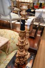 A PILLAR STYLE LAMP WITH SHADE AND ANOTHER ORNATE CANDELABRA