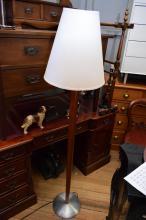 A MODERN TIMBER STANDARD LAMP