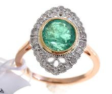 AN EMERALD AND DIAMOND RING - 1.72ct emerald surrounded by 0.28cts of diamonds set in 18ct gold