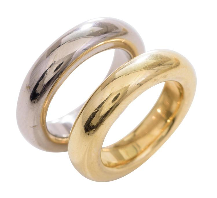 a pair of platinum and gold rings