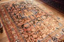 A PAKISTANI WOODEN HAND KNOTTED TRIBAL DESIGN IN ORANGE TONES (160x240cm)