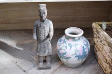 A POTTERY CHINESE WARRIOR AND FLOWER PAINTED POT