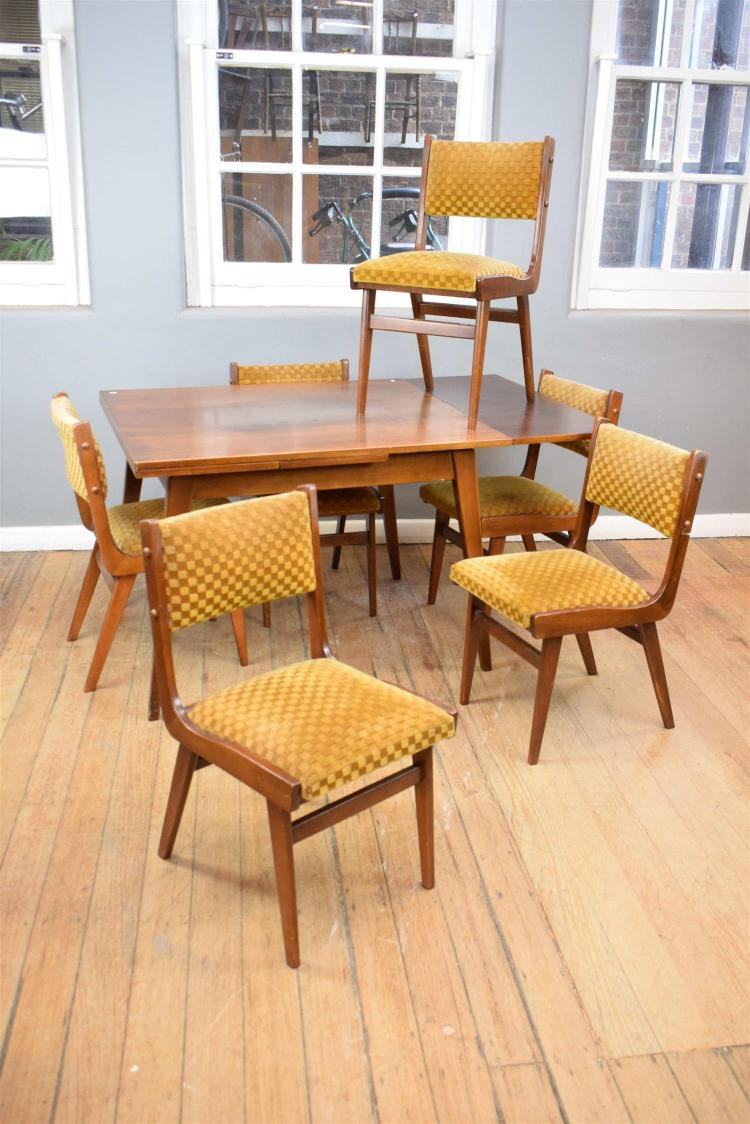 A 1960s EXTENTION DINING TABLE WITH SIX CHAIRS