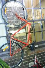 A VINTAGE POST MASTER GENERAL RED PUSHBIKE