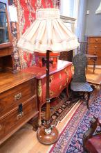 A FINE CARVED STANDARD LAMP WITH SHADE