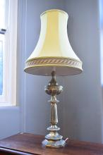 A BRASS TABLE LAMP WITH GREEN SHADE