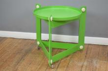 A RETRO VINTAGE KARTELL STYLE AUTO-TROLLEY IN GREEN (missing castor)
