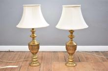 A PAIR OF DECORATIVE BRASS TABLE LAMPS WITH EGYPTIAN MOTIF
