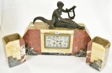 A GROSSEL-MAYAUX ART DECO THREE PIECE MANTLE CLOCK (bell and key with staff)