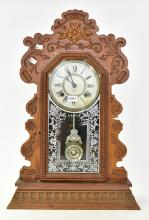 AN ANSONIA CARVED WOOD MANTLE CLOCK ( 57h X 37d )