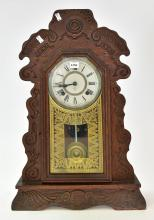 AN ANSONIA CARVED WOOD MANTLE CLOCK ( 57h X 38d )