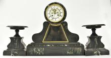 A THREE PIECE FRENCH MANTLE CLOCK (pendulum with staff)