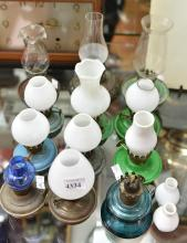 A COLLECTION OF MINIATURE KEROSENE LAMPS