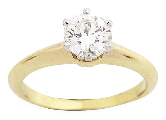 A SOLITAIRE DIAMOND RING BY TIFFANY & CO