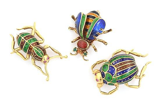 THREE GOLD AND ENAMEL BROOCHES
