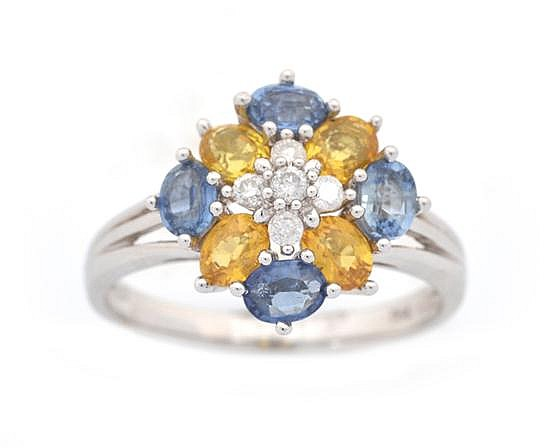 A COLOURED SAPPHIRE AND DIAMOND DRESS RING