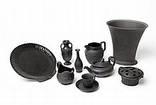 A GROUP OF TEN BLACK BASALT WEDGEWOOD PIECES WITH VARIOUS DESIGNS AND PATTERNS AND IMPRESSED MARKS TO BASE, 19TH / 20TH CENTURY.