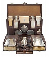 ART DECO LOUIS VUITTON GENTLEMAN'S VALISE NECESSAIRE, FITTED WITH FRENCH SILVER VANITY SET
