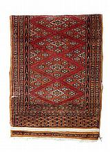AN INDIAN RUG, TOGETHER WITH ONE OTHER