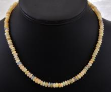 AN ETHIOPIAN OPAL BEAD NECKLACE WITH A SILVER CLASP.