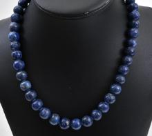 A STRAND OF LAPIS BEADS