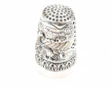 A THIMBLE AND PIN CUSHION IN SILVER