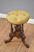 A VELVET COVERED VICTORIAN PIANO STOOL
