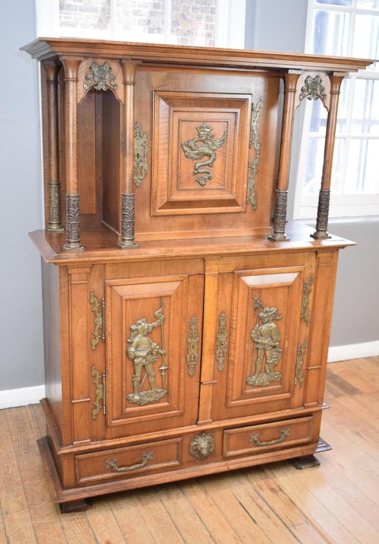 a henry ii walnut court cabinet with bronze heraldic fitting