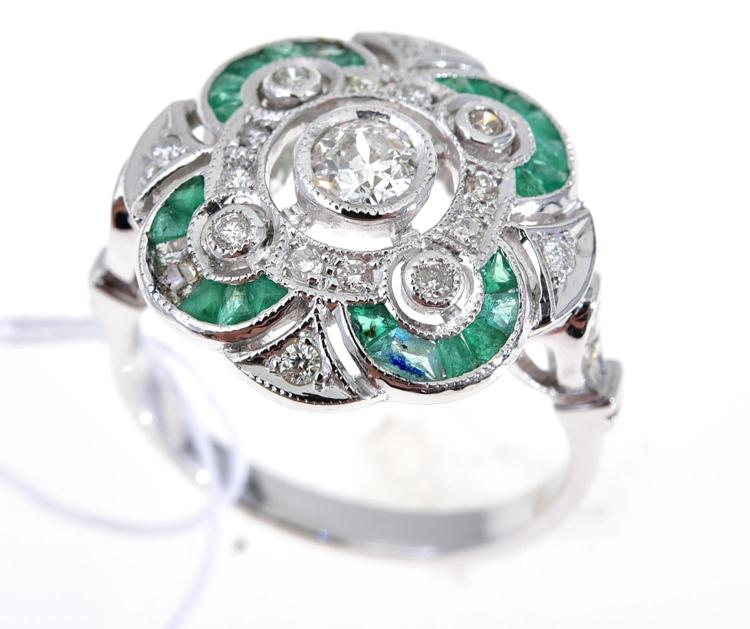 a and emerald filigree ring set in 18ct white gold
