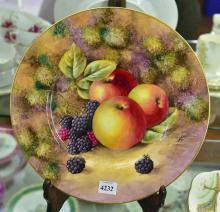 A ROYAL WORCESTER FRUIT AND BERRIES CABINET PLATE