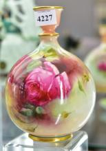 A ROYAL WORCESTER ROSES VASE BY HADLEY